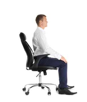 Man sitting in office chair on white background. Posture concept