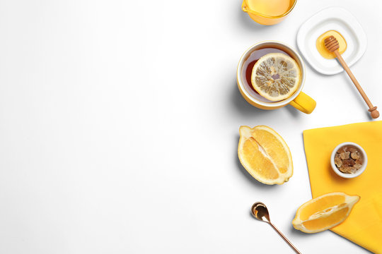 Composition with lemon tea on white background, top view. Space for text