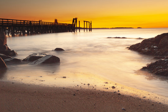 Autumn colors at sunrise overlooking a fishing pier