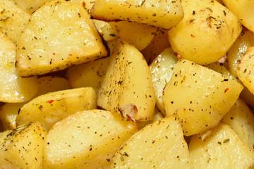 Appetizing and beautiful fried potatoes, yellow, with seasonings, close-up