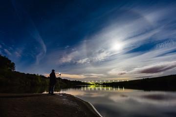 Photographer taking a photo of atmospheric phenomenon Halo