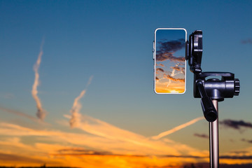Using smartphone on tripod to capturing stunning sundown