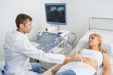 The pregnant lady pacient at ultrasonography examination