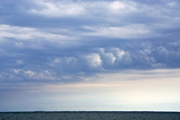 Dramatic, wind-swept clouds over the Chesapeake Bay.