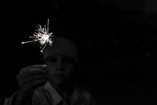 boy playing with sparklers
