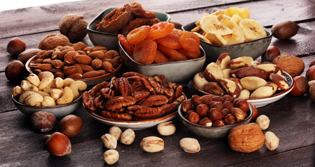 dried fruits and assorted nuts composition on rustic table