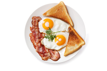 plate of fried eggs, bacon and toast isolated on white background