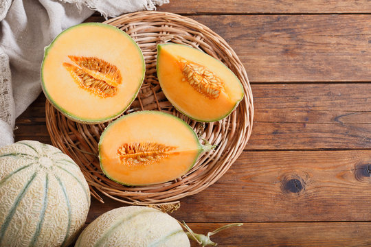 cantaloupe melon on wooden table