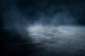 Background of an empty dark room. Empty walls, lights, smoke, glow, rays. Fotomurales