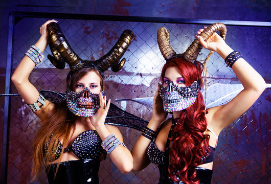 models wearing Halloween costume of leather and horns