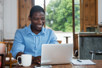 African american man with laptop