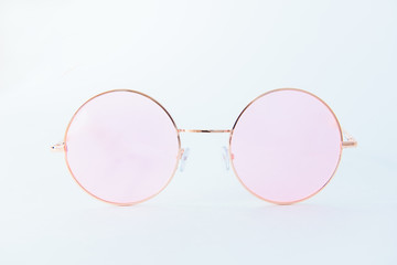 Round Italian sunglasses on white background. Pink eyeglasses. Front view of glasses with rounded retro frames