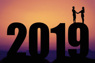 Sunset with New year 2019 silhouette with couple in love