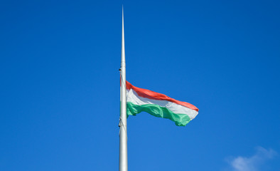 Hungarian Flag at wind and blue sky