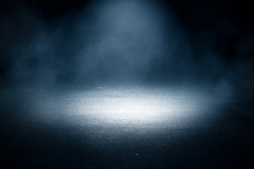 Background of an empty dark street, wet asphalt. Spotlight, smoke, fog