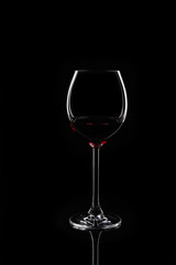 Glass of red wine at black background
