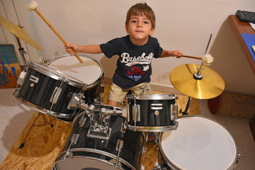 Child having fun playing a drums.
