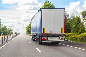 truck transports freight on highway