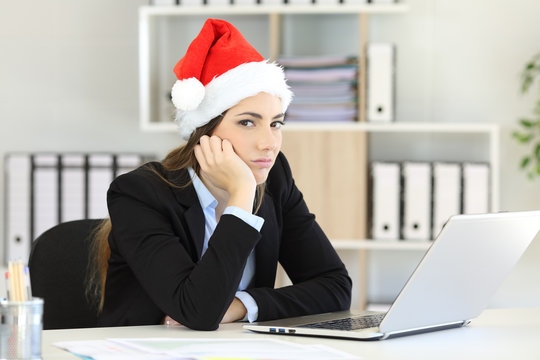 Sad office worker working in christmas time