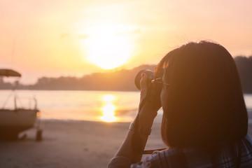 Woman Put on a shirt plaid pattern. trip, sea photograph in Phuket, Thailand morning light