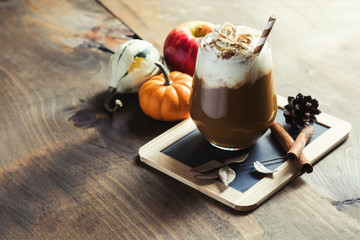 Pumpkin latte with spices, coffee autumn of fall drink with pump