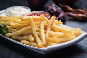 French fries with ketchup and mayonnaise