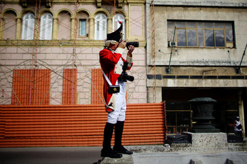 """A reveller dressed as soldier, from the Cologne carnival society """"Rote Funken"""", takes pictures in Havana"""
