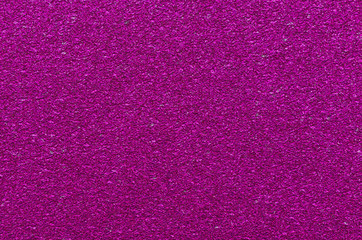Ruby glitter texture. Christmas or new year background for design.