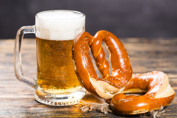 Oktoberfest concept - beer mug with german pretzel