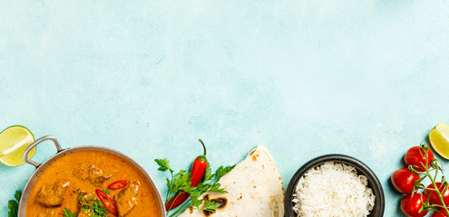 Traditional curry on blue background