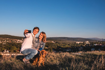 Happy young cute couple making selfie outdoors