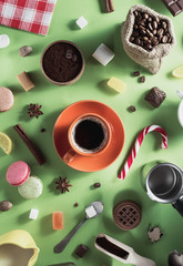 coffee cup and beans at green background