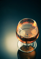 cognac and  glass  on black
