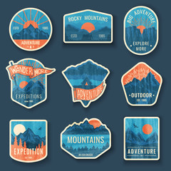 Set of nine mountain travel emblems with grunge texture. Camping outdoor adventure emblems, badges and logo patches. Mountain tourism, hiking. Forest camp labels in vintage style