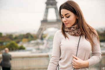 Attractive young lady stand in centre of paris. Background of eiffel tower. Travel