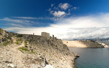 Ruine of fortress and the Pag bridge, Island of Pag, Croatia
