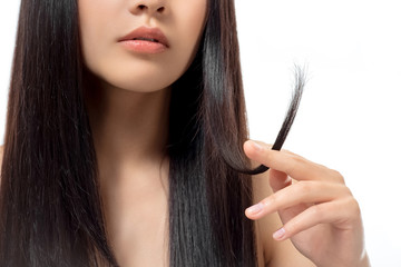 cropped shot of woman with damaged dark hair isolated on white, split ends concept