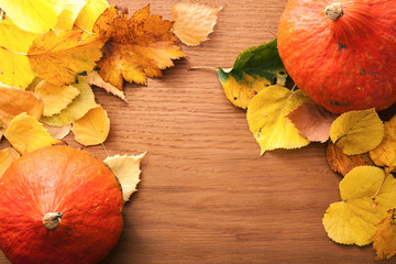 Autumn composition with yellow leaves and pumpkin