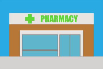 Edificio marrón de una farmacia.