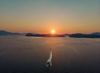 Boat sailing into the sun in Mediterranean