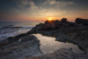 Dawn among the rocks / Sea sunrise at the Black Sea coast near Rezovo, Bulgaria