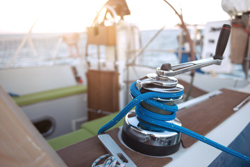 Winch with rope on a sail boat in the sea