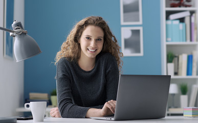 Young woman connecting with her laptop