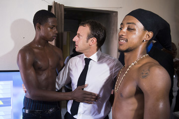 French President Emmanuel Macron speaks with youths in the Quartier Orleans during a visit to the French Caribbean island of Saint-Martin