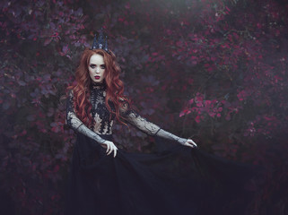 A beautiful gothic princess with pale skin and long red hair wearing a crown and a black dress against the backdrop of burgundy leaves.