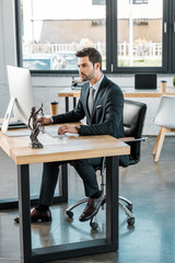 handsome lawyer working with computer at table in office