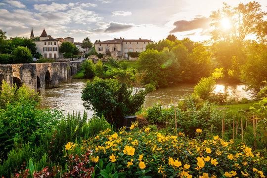 Medieval bridge and Barbaste village on background