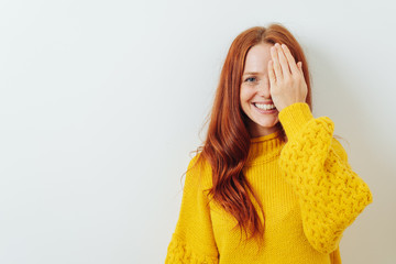 Happy smiling woman covering on eye