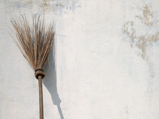 Old broom Laid against the wall