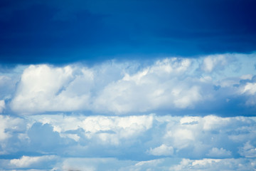 Beautiful clouds with blue sky background. Nature, weather and sun